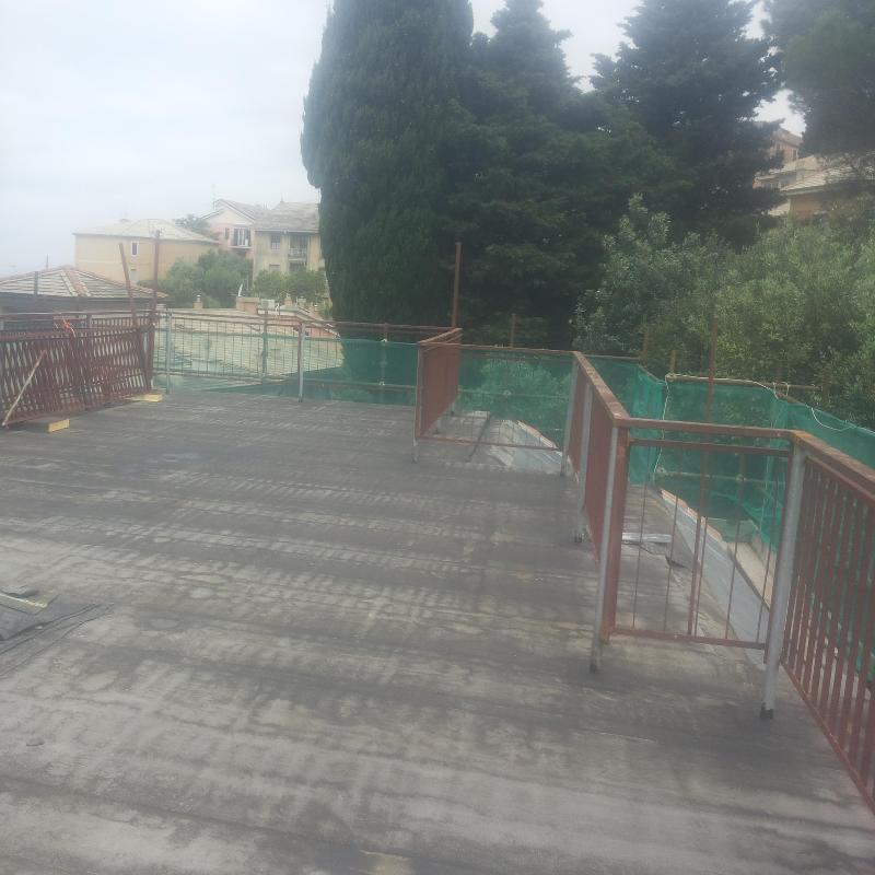 Terrazzo in fase di finitura